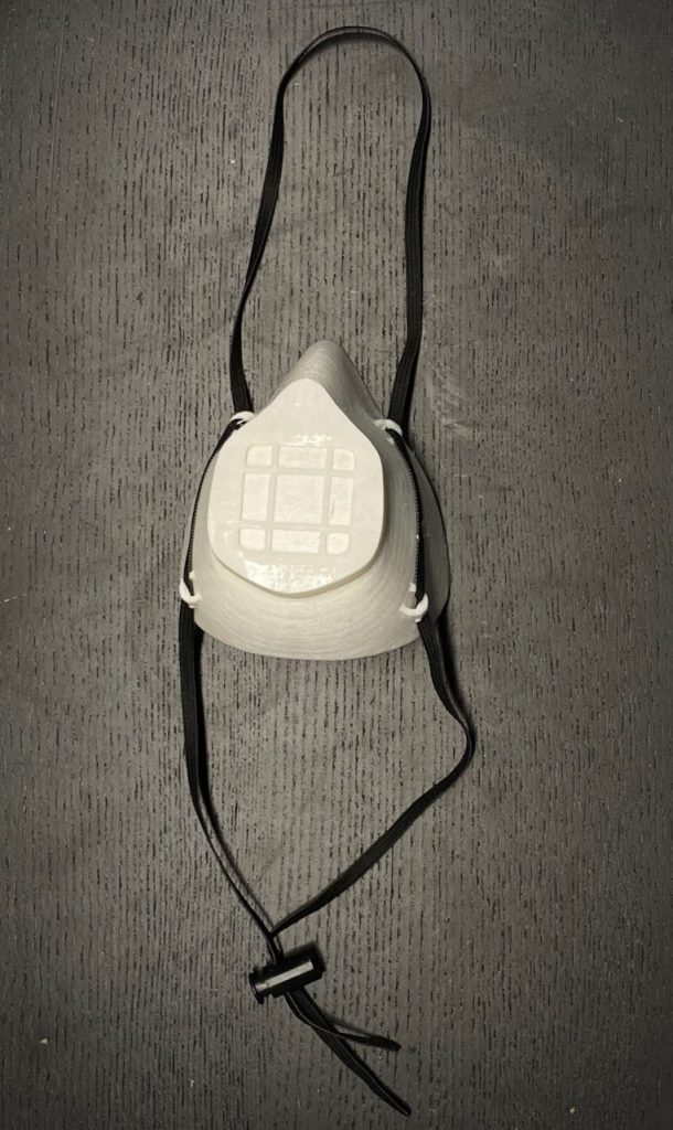 White 3D printed mask with black strapping