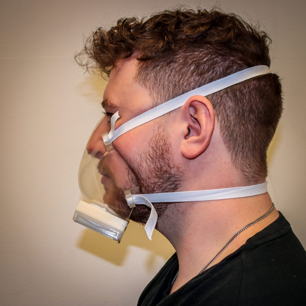 The Harbec mask is an injection molded clear mask. It features a reusable filter cartridge with MERV-15 material within a curved corrugated cassette to maximize breathability and filtration.