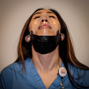 The vacuum formed BEclear mask system is a lightweight reusable clear mask adapter combined with a certified face mask.