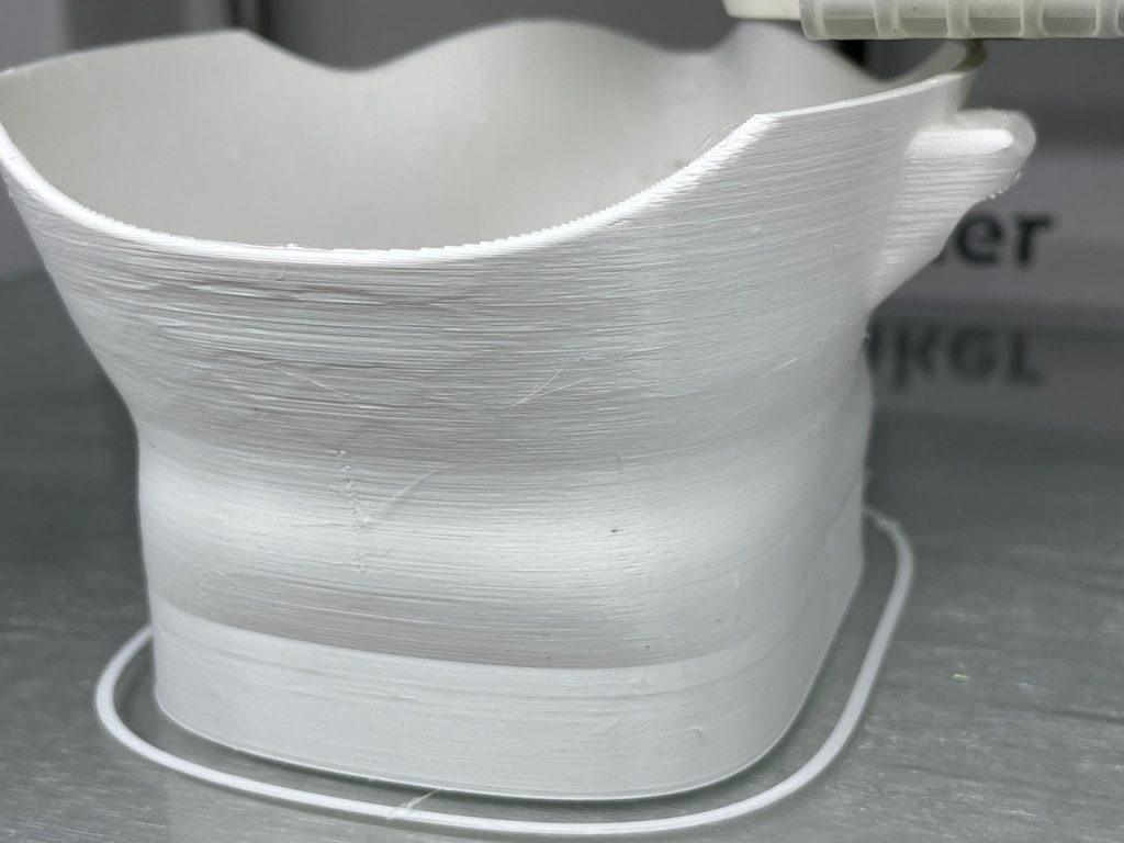 Close-up of white 3D printed mask